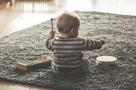 Small child playing music.