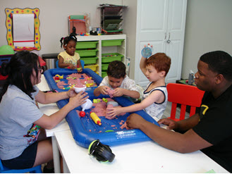 Children playing with sensory sand